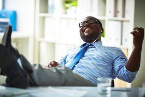 man listening to music at work   Constellation Nutrition