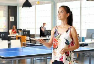 woman playing table tennis at work | Constellation Nutrition